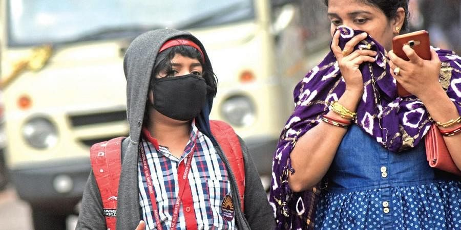 A school student and her mother covering their faces for protection against coronavirus in Bhubaneswar on Friday