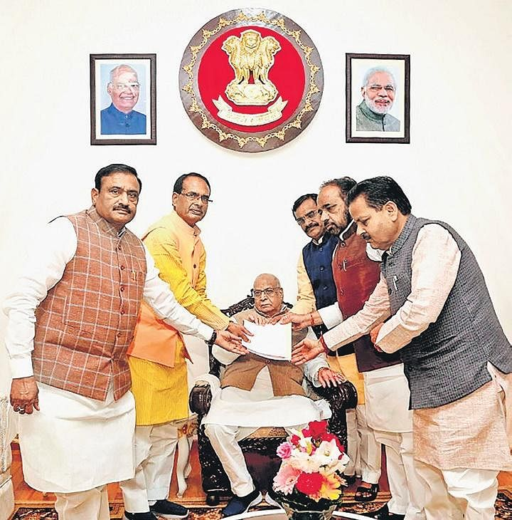 BJP vice-president Shivraj Singh Chouhan (second from left), along with party leaders, submits a memorandum to Governor Lalji Tandon in Bhopal on Tuesday