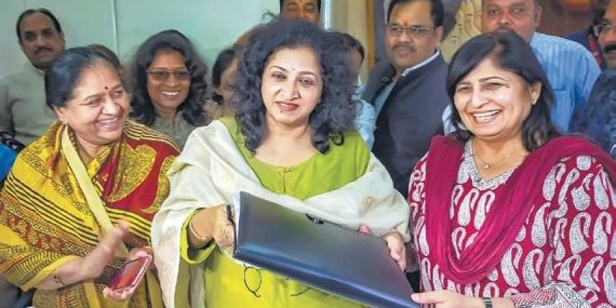 Congress leader Shobha Oza (centre) takes charge as chairperson of Madhya Pradesh Women's Commission in Bhopal