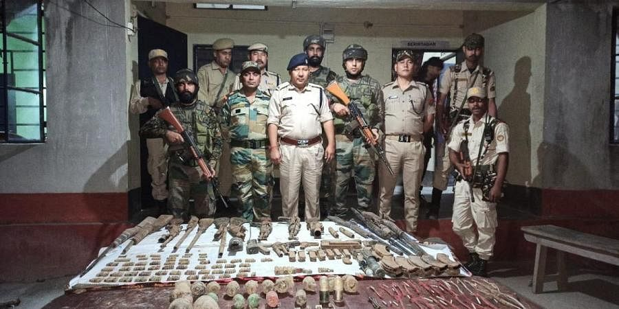 The police and army team with the seized items