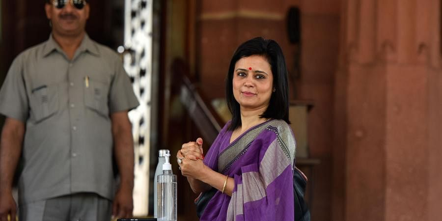 Trinamool Congress MP Mahua Moitra sanatizes her hands at Parliament during the ongoing Budget Session in New Delhi