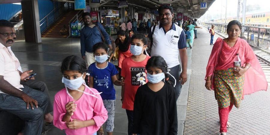 Passengers wearing masks in the view of Coronavirus in Vijayawada railway station.