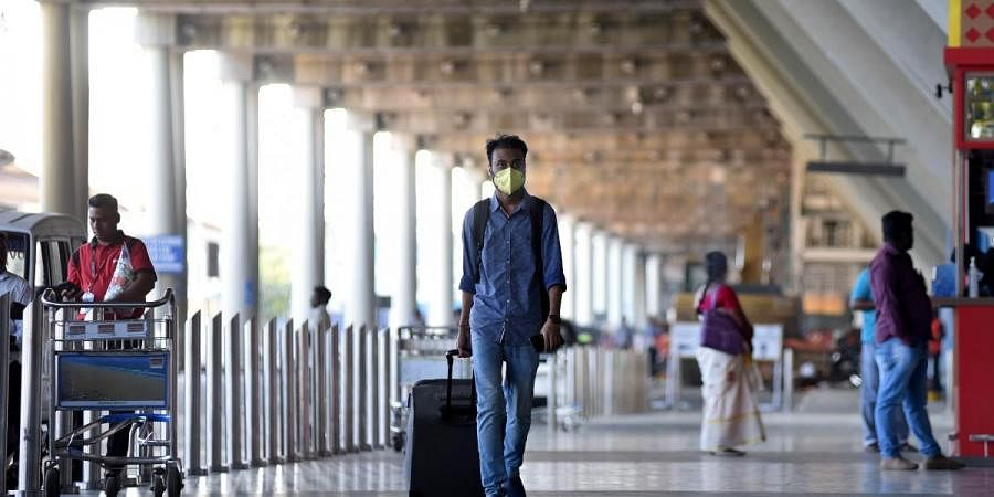 Passengers are seen wearing masks to keep them away from coronavirus at Chennai Airport