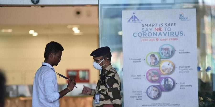 Security at airport wars mask to prevent COVID-19 . (Photo| EPS/ R Satish Babu)
