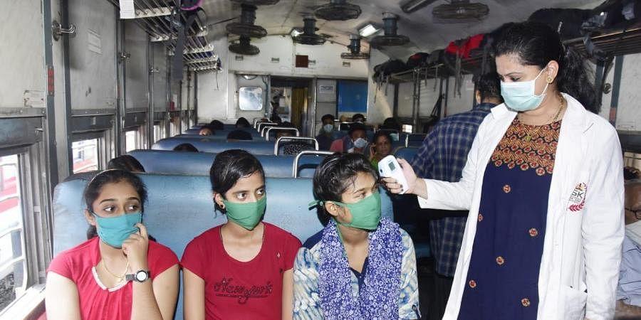 People get screened inside trains. (Photo| EPS/ G satyanarayana)
