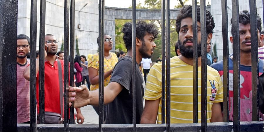 One of the three gates at EFLU locked by the police to prevent students from leaving the campus to take part in a protest against CAA in Hyderabad on Sunday