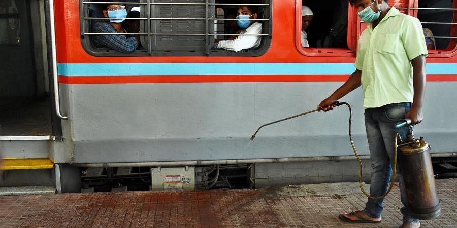 People seen with Mask at Chennai Central Railway Station on Monday