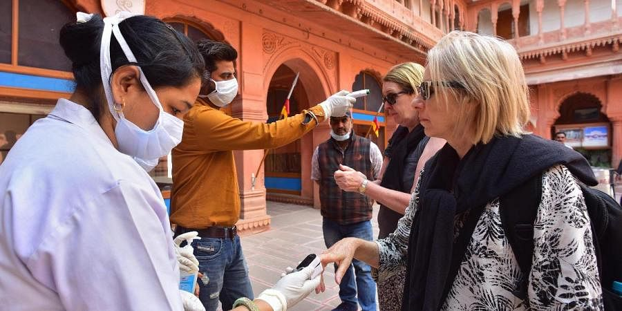 Medics screen tourists in view of the novel coronavirus COVID-19 outbreak at Junagarh fort in Bikaner