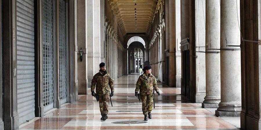 Italian soldiers patrol downtown Milan, Italy