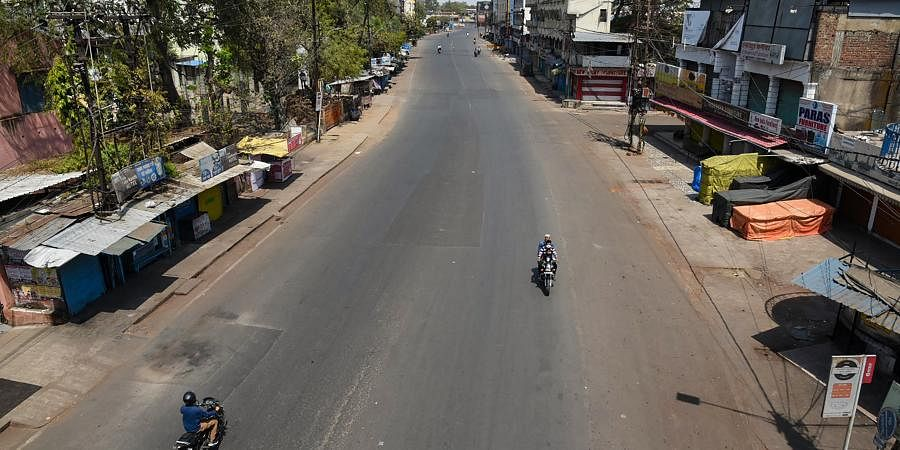 A city street wears a deserted look during 'Janata curfew' in the wake of coronavirus pandemic in Bhopal Sunday March 22 2020.