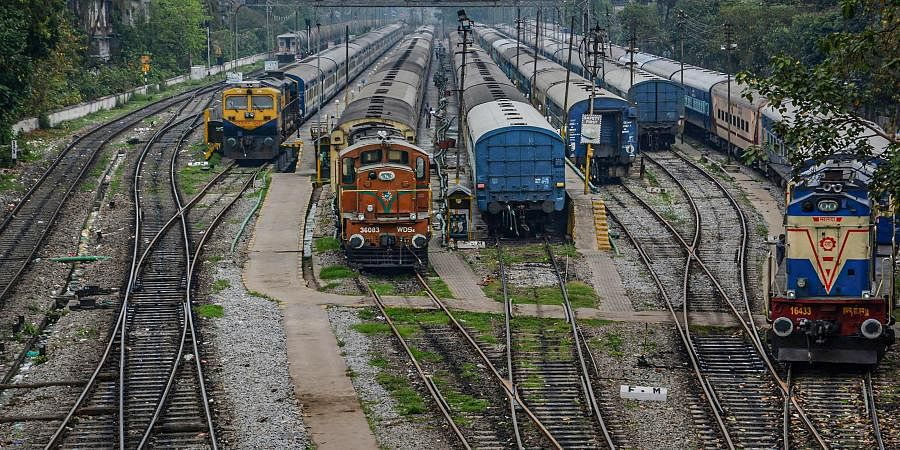 Trains stand parked at a deserted railway station during 'Janata curfew' in the wake of coronavirus pandemic in Guwahati. (Photo | PTI)