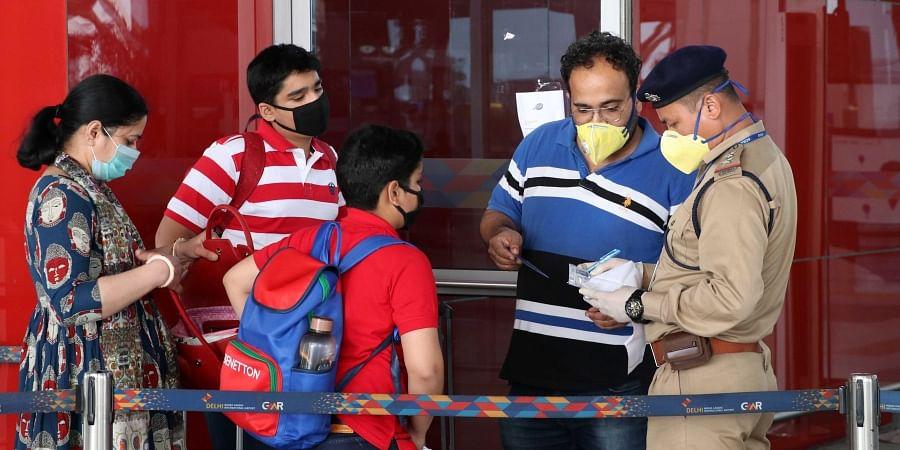 Passengers wearing masks in the wake of Coronavirus outbreak at Indira Gandhi International airport in New Delhi