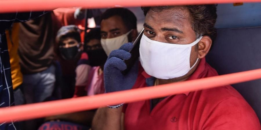 Passengers wearing protective masks travel in a crowded Gorakhpur bound train amid worldwide coronavirus scare at Lokmanya Tilak Terminus in Mumbai