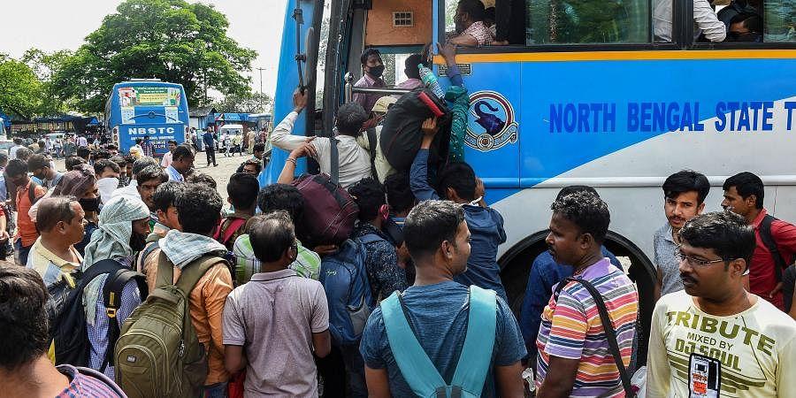 Passengers board a long route bus before lockdown in the wake of coronavirus pandemic in Kolkata. (Photo   PTI)