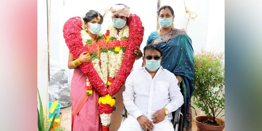 Vijayakanth and his wife Premalatha with the couple.