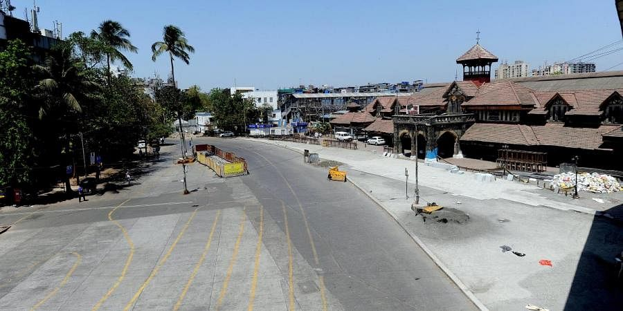 A deserted view of the road amid coronavirus lockdown, in front of Bandra railway station in Mumbai on Monday