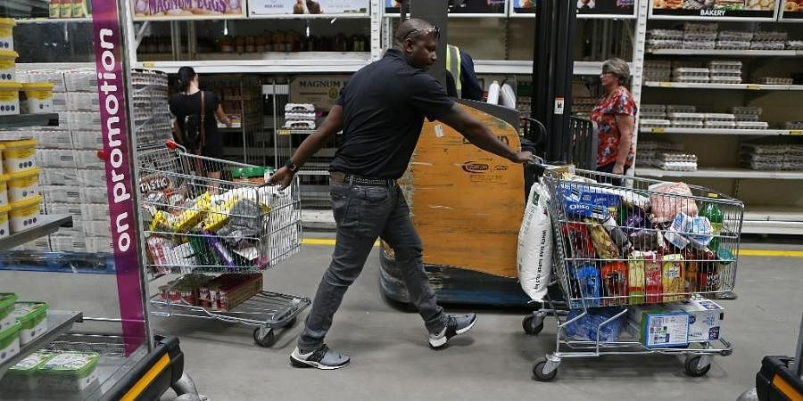 A South African man hoards food after the announcement of lockdown to fight coronavirus. (Photo| AFP)