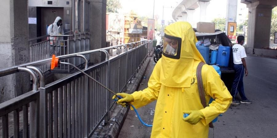 GHMC's Disaster Response Force worker seen spraying disinfectant at ESIC metro station in Hyderabad on Tuesday