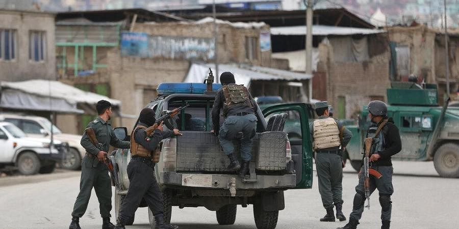 Afghan personnel arrive at the site of an attack in Kabul, Afghanistan, Wednesday, March 25, 2020.