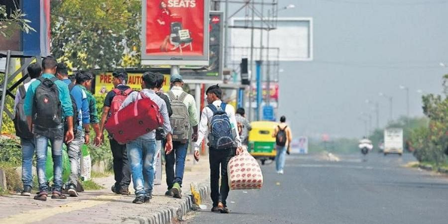 Migrant workers leave for home amid lockdown in New Delhi