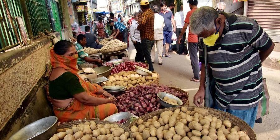 People buying vegetables from a market during coronavirus lockdown  in Kolkata