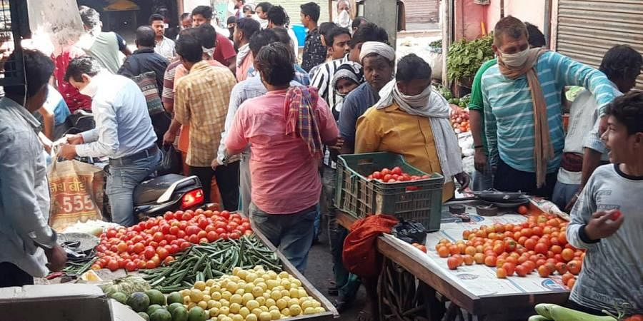 People buying vegetables and other essentials after the announcement of lockdown throughout the country for 21 Days, in Mathura