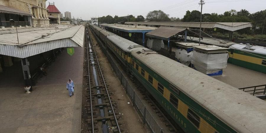 A railway station is deserted after authorities shut down railway service in an effort to contain the new coronavirus, in Karachi, Pakistan Wednesday, March 25, 2020. Pakistani authorities said they'd shut down train operations across the country from Wednesday until March 31.