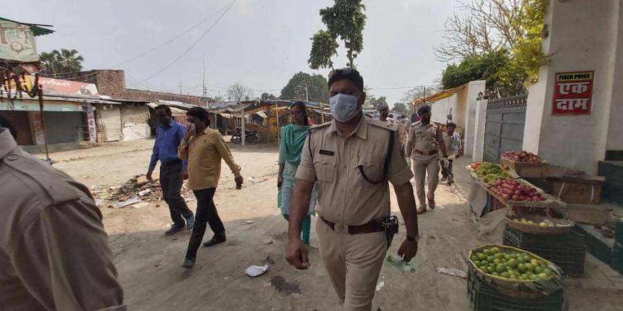 Police enforcing lockdown in a deserted area at Patna