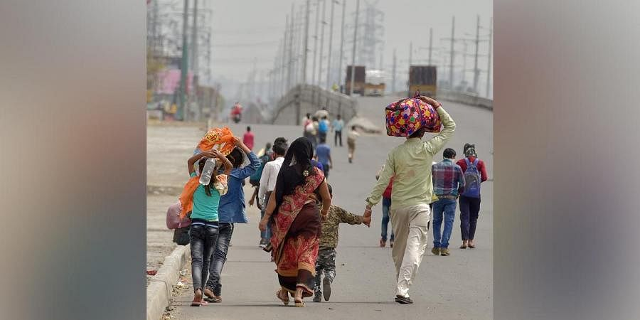 Migrant workers return to their villages on foot amid lockdown due to coronavirus. (Photo| PTI)