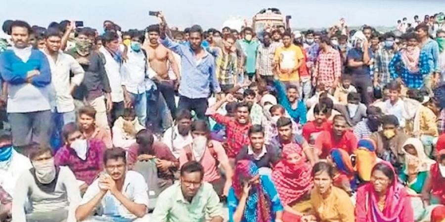 Students stage a protest demanding that they be allowed into AP at Pungudala bridge in Krishna dist on Thursday