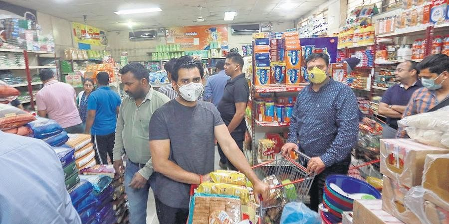 People seen shopping at a supermarket in the wake of the coronavirus outbreak.