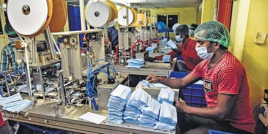 Workers at a surgical mask manufacturing unit in Hyderabad.