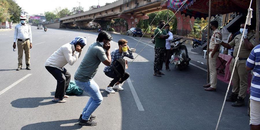 Police punishing lockdown violators in Hyderabad. (Photo| EPS/ S Senbagapandiyan)