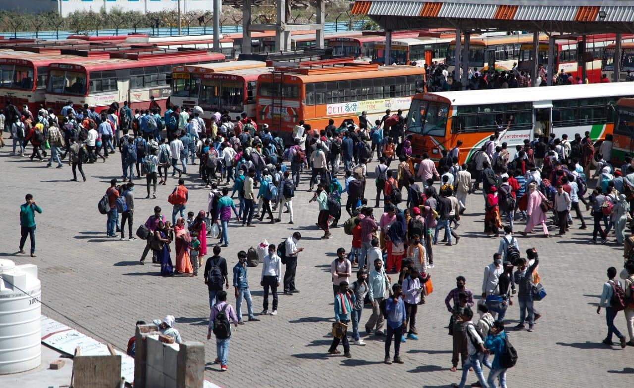 Migrants workers crowd at Kaushambi bus station at Delhi-Ghaziabad border hoping to catch a bus to their village.