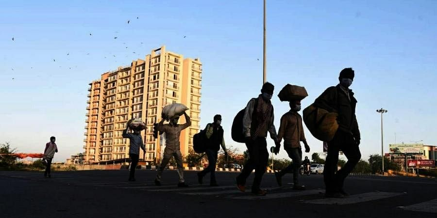 Migrant workers walk to their native amid complete lockdown. (Photo  EPS/ Parveen Negi)