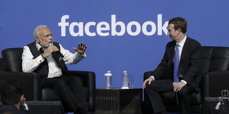 Prime Minister of India Narendra Modi, left, speaks next to Facebook CEO Mark Zuckerberg at Facebook. ( AP Photo)