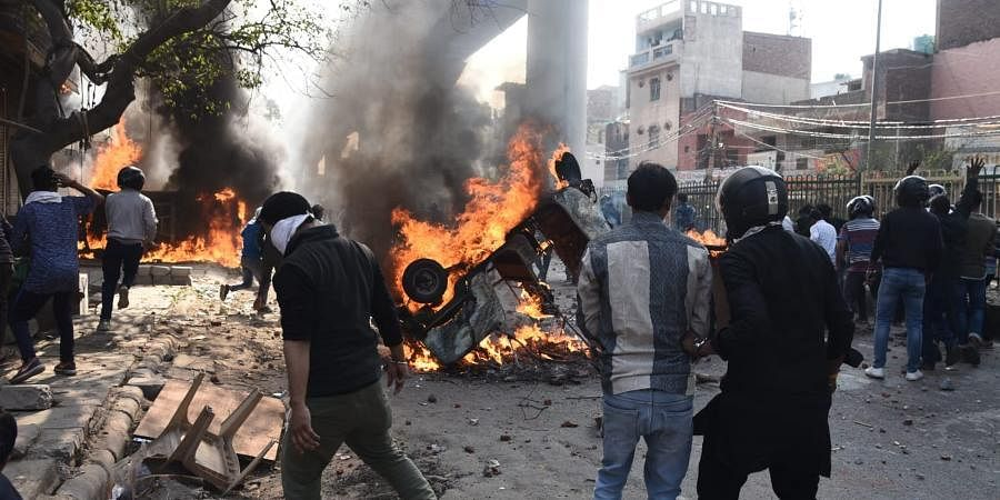 Protesters during clashes between a group of anti and pro-CAA supporters at Jafrabad in north-east Delhi on Monday
