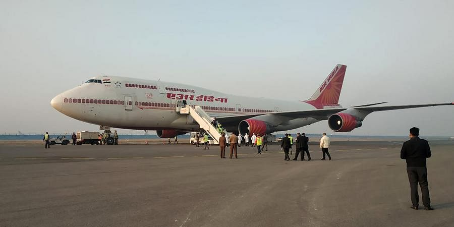This handout photo provided by the Indo-Tibetan Border Police shows an Air India aircraft that brought back Indians from Wuhan stands after arrival at the airport in New Delhi, India, Saturday, Feb. 1, 2020.