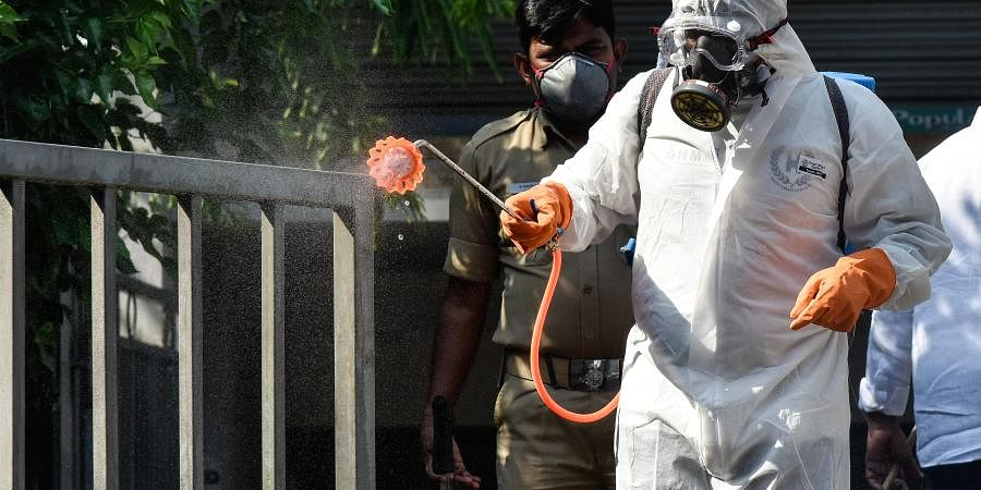 Spraying sanitation chemical at Ram koti in Hyderabad on Friday during lockdown till April 14th in view of coronavirus.