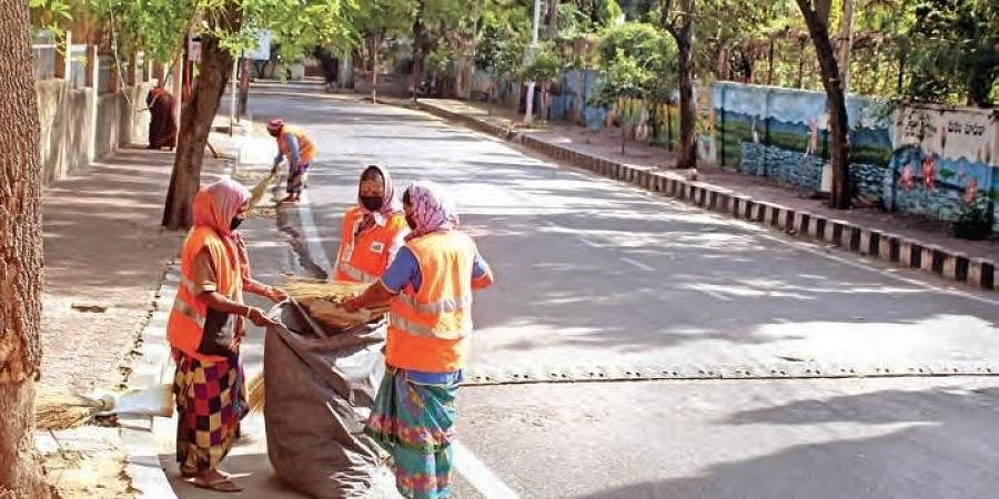 GHMC workers clean the roads in Begumpet in Hyderabad