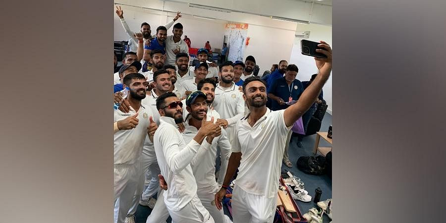 Saurashtra cricket team players click a selfie after win over Gujarat on day five of their semifinal here on Wednesday.