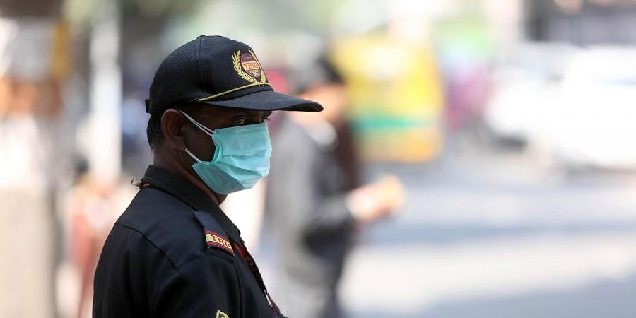 People wearing a protective mask in the wake of novel coronavirus or COVID-19 outbreak at Safderjung Hospital in New Delhi on Wednesday.