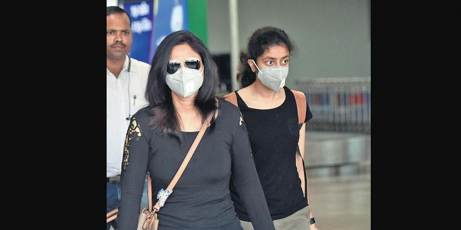 As coronavirus fear grips the country, passengers arrive at Biju Patnaik International Airport wearing mask in Bhubaneswar on Wednesday. (Photo | Biswanath Swain, EPS)