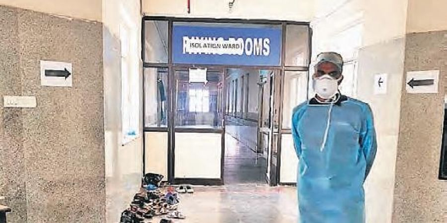 A man in protective gear outside the isolation ward at Gandhi Hospital.