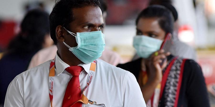 Airport Staff wearing face mask to avoid Corona Virus at Chennai International Airport in  on sunday. (Photo | R Satish Babu/EPS)