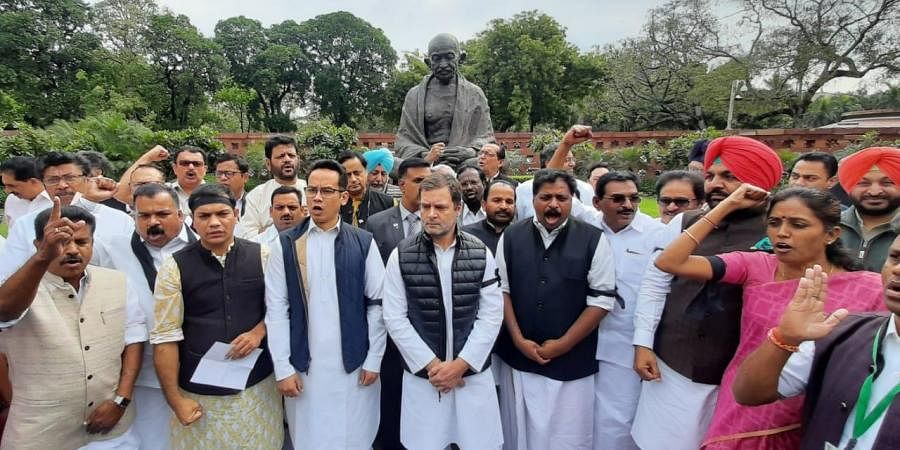Congress Party led by Rahul Gandhi staging a protest demonstration demanding resignation of Home Minister Amit Shah at Parliament house in New Delhi on Friday.