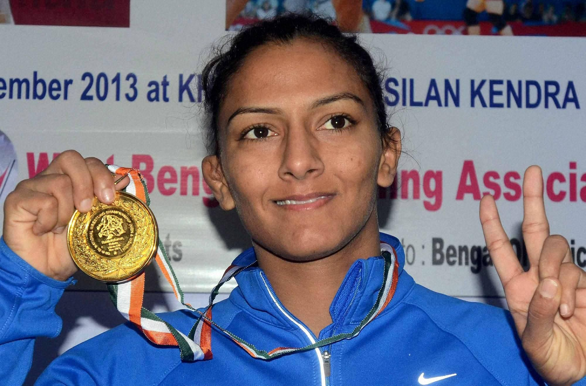 Geeta Phogat won India's first ever gold medal in wrestling at the commonwealth Games in 2010 and is also the first Indian wrestler to have qualified for Olympic summer games. Geeta, one of the five daughters of the family, was coached by her father Mahavir Singh Phogat who was also a wrestler. The life story of Mahavir Singh Phogat and her sisters were made as Hindi movie called 'Dangal'.