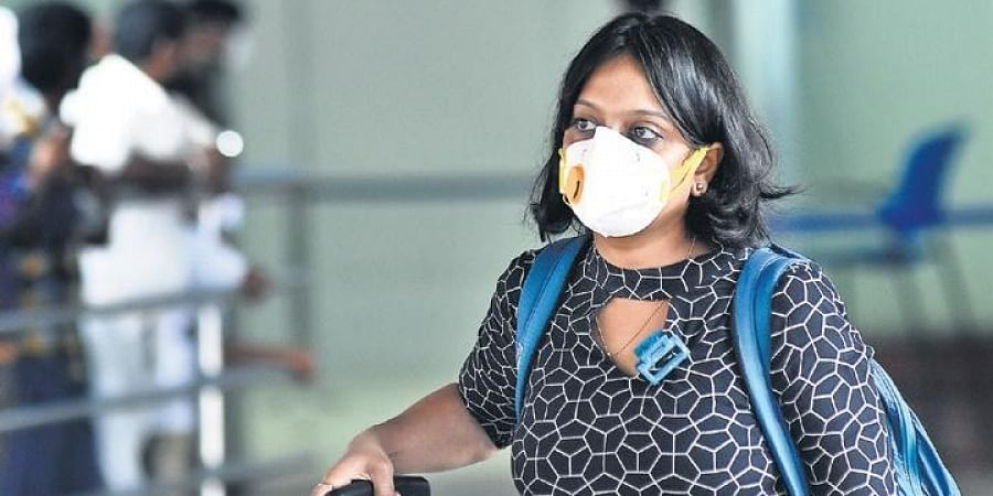 A passenger at the Chennai airport with her face mask on Friday