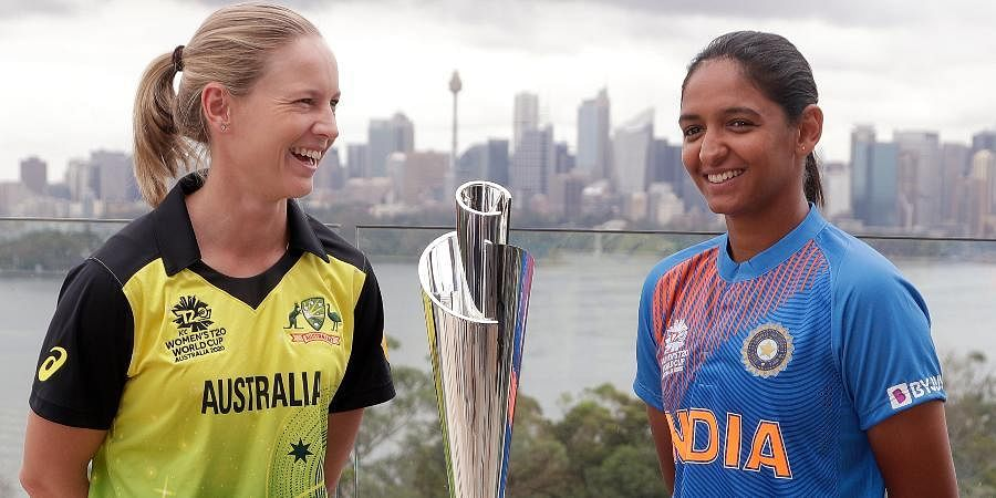 Cricket captains Meg Lanning of Australia, left, and Harmanpreet Kaur of India pose for a photo with the trophy ahead of the Women's T20 World Cup in Sydney.