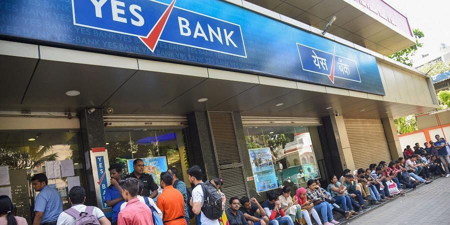 Account holders queue up outside Yes Bank to withdraw money in Mumbai on Saturday